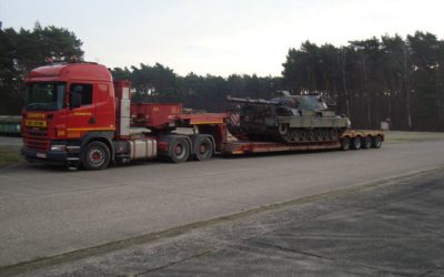 Transport with deep loader of tank